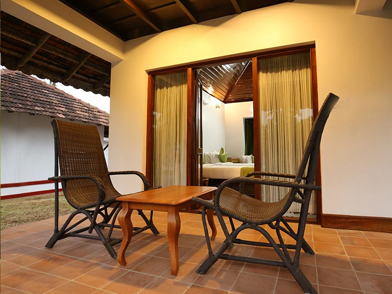 seating area of kerala cottage room